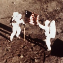 Neil Armstrong and Buzz Aldrin plant the US flag on the moon on July 20, 1969