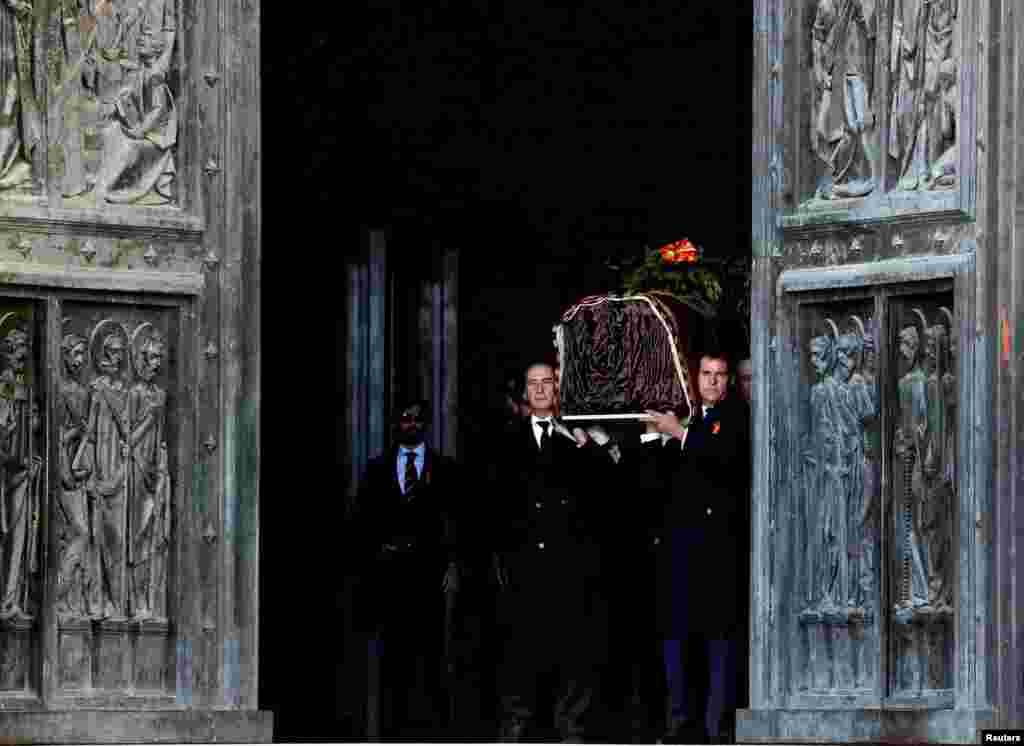 The family members of the late Spanish dictator Francisco Franco carry his coffin at The Valle de los Caidos (The Valley of the Fallen) in San Lorenzo de El Escorial, Spain.