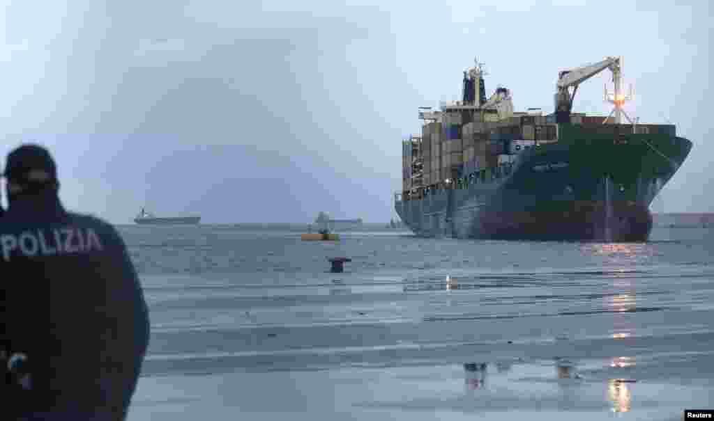 "The ""Spirit of Piraeus "" cargo container ship, transporting passengers from the car ferry Norman Atlantic after it caught fire in waters off Greece, is pictured after arriving at Bari harbor, December 29, 2014."