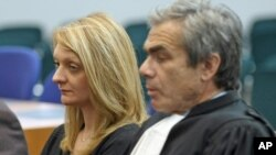 Rachel Lambert, wife of Vincent Lambert, a Frenchman who has been comatose for seven years, attends with her lawyer Laurent Petiti a verdict about her husband in the European Court of Human Rights in Strasbourg, France, June 5, 2015.