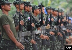 Karen National Union (KNU) soldiers hold their assault weapons as they parade during the celebration of the 63rd anniversary of the Karen Revolution day at Oo Kray Kee village in Karen State, near the Thai-Myanmar border on January 31, 2012. The KNU is w