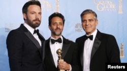 """Producer and director Ben Affleck (L) poses with """"Argo"""" producers Grant Heslov (C) and George Clooney after Affleck won Best Director and """"Argo"""" won the award for Best Motion Picture Drama at the 70th annual Golden Globe Awards in Beverly Hills, Californi"""