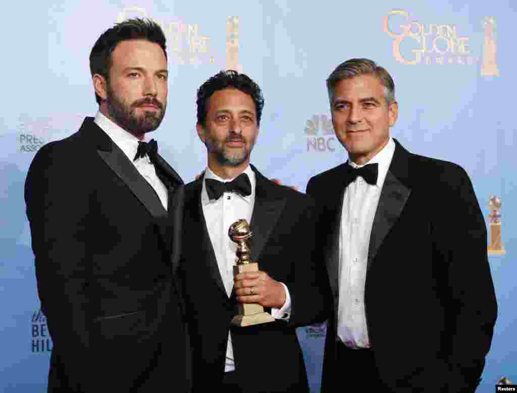 "Producer and director Ben Affleck (L) poses with ""Argo"" producers Grant Heslov (C) and George Clooney after Affleck won Best Director and ""Argo"" won the award for Best Motion Picture Drama at the 70th annual Golden Globe Awards in Beverly Hills, Californi"