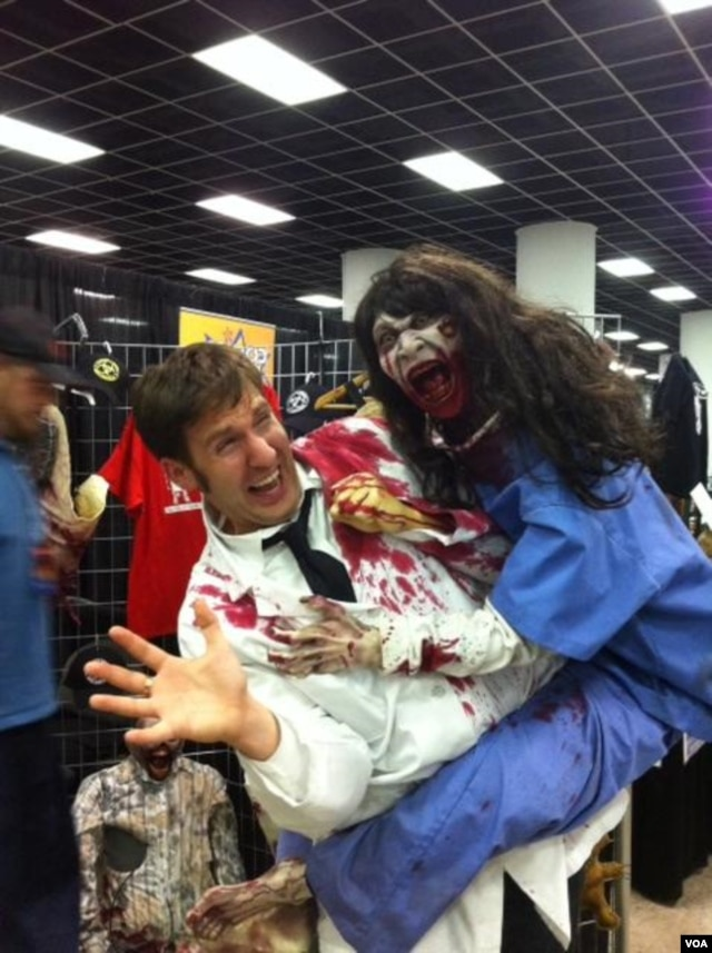 A man holds a zombie doll at the Walker Stalker convention in Atlanta, Georgia. (Marissa Melton for VOA)