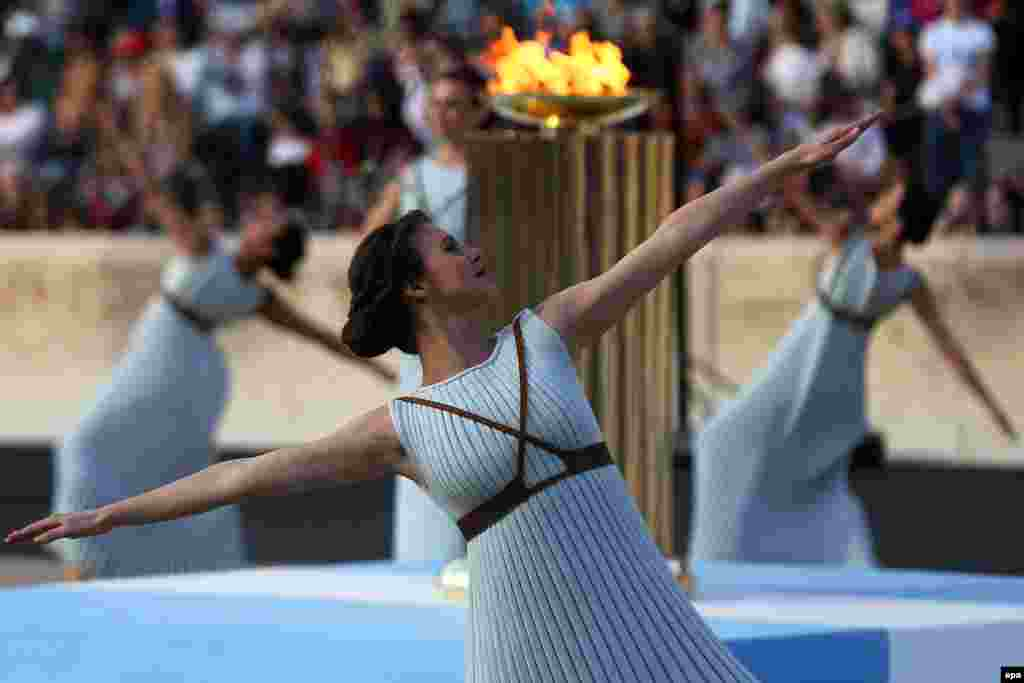 Actresses playing the role of Priestesses perform during the handover ceremony of the Olympic flame in the Panathenaic Stadium, where the first modern games were held in 1896, in Athens, Greece.