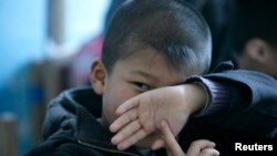 FILE - An autistic child attends a therapy session in Beijing, China, March 23, 2009.