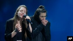 "Salvador Sobral from Portugal, right, performs the song ""Amar pelos dois"" with his sister Luisa after winning the Final of the Eurovision Song Contest, in Kyiv, Ukraine, May 13, 2017."