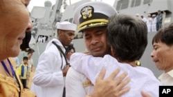 "U.S. navy officer Michael ""Vannak Khem"" Misiewicz becomes emotional as he embraces his aunt Samrith Sokha, 72, at Cambodian coastal international sea port of Sihanoukville."