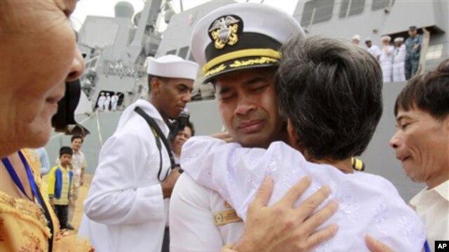 "U.S. navy officer Michael ""Vannak Khem"" Misiewicz becomes emotional as he embraces his aunt Samrith Sokha, 72, at Cambodian coastal international sea port of Sihanoukville."
