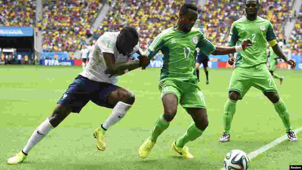 France's Blaise Matuidi fights for the ball with Nigeria's Ogenyi Onazi and Joseph Yobo.