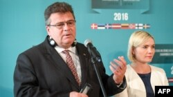 FILE - Lithuania's Foreign Minister Linas Linkevicius (L) during a press conference after the Baltic and Nordic Foreign Ministers meeting in Riga, Latvia, Aug. 26, 2016.