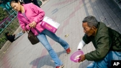 Some say China's new charity law is mean to make donating easier for China's middle and upper classes.