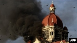 This file photograph taken on 27 Nov 2008 shows flames gushing out of The Taj Mahal Hotel in Mumbai.