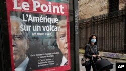 "The front page of French weekly newspaper Le Point displays a photo of President Donald Trump and Democratic presidential candidate former Vice President Joe Biden with a headline reading ""America on a volcano, (and Us too)"" in Paris, Wednesday Sept. 30,"