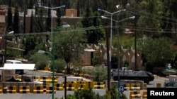 A general view shows the concrete barriers at the entrance to the U.S. embassy in Sanaa, Yemen, August 7, 2013.