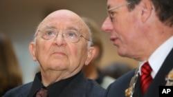 FILE - Israeli author Aharon Appelfeld, left, sits next to Dortmund's mayor, Gerhard Langemeyer, during the award ceremony of the Nelly-Sachs award for Appelfeld's career in Dortmund, Germany, Dec. 4, 2005.