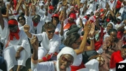 Hundreds of women march during a protest against Senegal's President Abdoulaye Wade's controversial third term bid for presidency, in Dakar, February 24, 2012.
