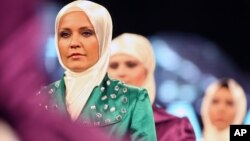 Models wear creations by a Turkish Islamic fashion house for its spring-summer 2008 ready-to-wear collection in Ankara, Turkey, Monday, March 3, 2008.