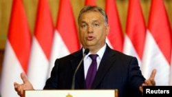 FILE - Hungarian Prime Minister Viktor Orban attends a news conference in Budapest, Hungary, Oct. 4, 2016.
