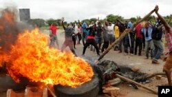 FILE: Protestors gather near a burning tyre during a demonstration over the hike in fuel prices in Harare, Zimbabwe, Tuesday, Jan. 15, 2019.