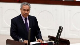 FILE - Turkey's Deputy Prime Minister Bulent Arinc addresses the Turkish Parliament in Ankara in a 2013 photo.
