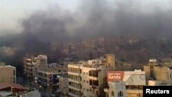 A view shows the smoke rising in the city of Hama in this still image taken from video on July 31, 2011. Syrian army tanks firing shells and machine guns stormed the city of Hama on Sunday, killing at least 45 civilians in a move to crush demonstrations a