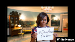 The White House posts a Twitter photo showing First Lady Michelle Obama holding a sign with hashtag #BringBackOurGirls, May 7, 2014.