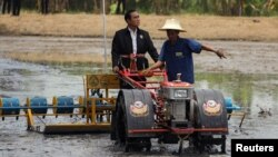 Thailand's Prime Minister Prayuth Chan-ocha rides on a tractor at a farmer school in Suphan Buri province, Thailand, Sept. 18, 2017.
