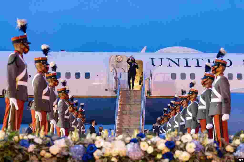 U.S. Vice President Kamala Harris waves upon arrival at the Aeropuerto Internacional La Aurora in Guatemala City, June 6, 2021.