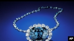 "In this photo from the Smithsonian Institution,The Hope Diamond is seen in Washington. The famed diamond glows a mysterious red when exposed to ultraviolet light, a finding that scientists say can help them ""fingerprint"" diamonds and tell the real ones fr"