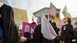 Nuns of the Order of St. Francis rally outside the Supreme Court in Washington, March 23, 2016, as the court hears arguments to allow birth control as part of healthcare plans.