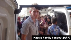 FILE - Abdul-Rahman Kassig is shown in a Kassig family photo somewhere along the Syrian border between late 2012 and autumn 2013 helping Special Emergency Response and Assistance (SERA) deliver supplies to refugees.