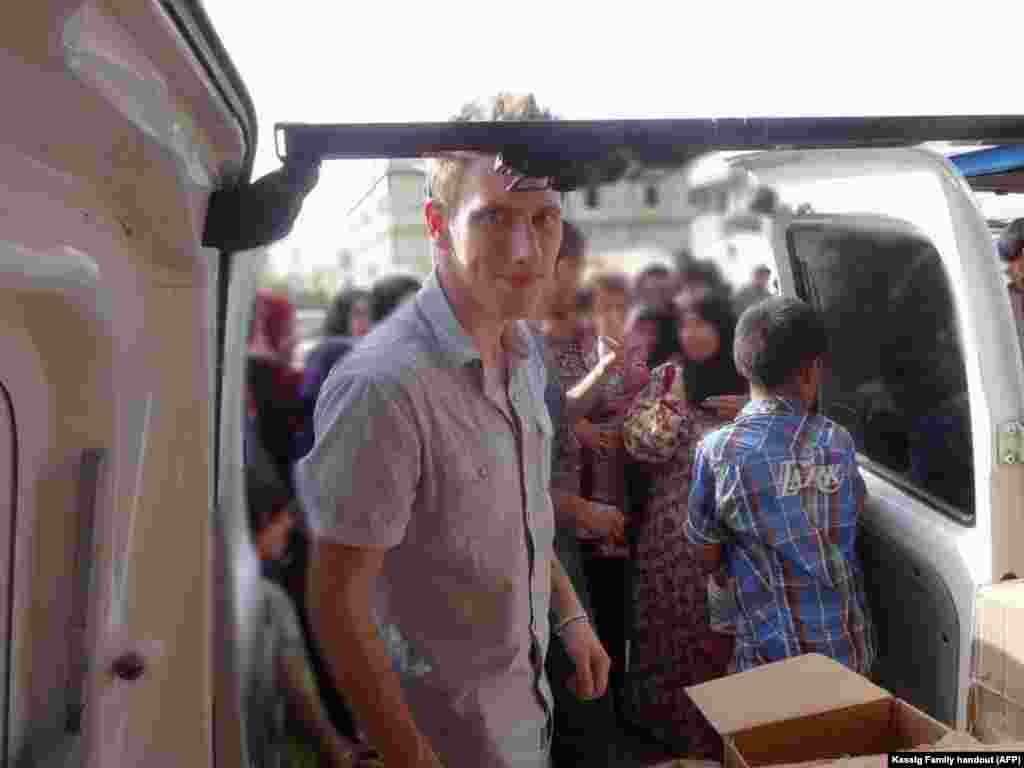 Abdul-Rahman Kassig is shown in a Kassig family photo somewhere along the Syrian border between late 2012 and autumn 2013, helping Special Emergency Response and Assistance (SERA) deliver supplies to refugees.