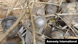 Bomblets from a cluster bomb inside a house in Andona village, Dalami County in Sudan's South Kordofan State