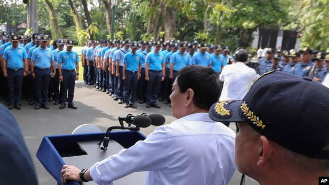 FILE - Philippine President Rodrigo Duterte speaks to erring policemen during an audience at the Presidential Palace grounds in Manila, Philippines, Feb. 9, 2017.