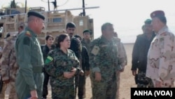 SDF forces & Iraqi army coordinate at border
