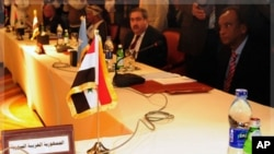 The seat of the Foreign Minister of Syria is seen empty during a meeting for Arab foreign ministers in Cairo, to discuss the situation in Syria, November 24, 2011.