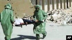 People in protective suits and gas masks conducting a drill on how to treat casualties of a chemical weapons attack in Aleppo, Syria, in this image made from an AP video posted on Wednesday, Sept. 18, 2013.
