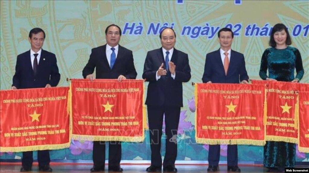 Hôm 2/1/2020, Thủ tướng Việt Nam Nguyễn Xuân Phúc dự Hội nghị Triển khai nhiệm vụ ngân hàng năm 2020. Photo TTXVN.