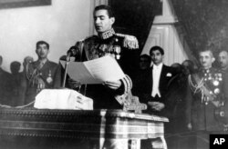 FILE - The Shah of Iran, Mohammad Reza Pahlavi, reads his inaugural speech at the initial session of his nation's first senate in Tehran, Iran, Feb. 16, 1950.