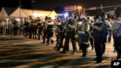 Police advance to clear the crowd, Ferguson, Missouri, Aug. 18, 2014