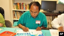 Mr. Peter Ouch, a Cambodian survivor of the Khmer Rouge regime, takes part in an art project that is designed to help survivors deal with trauma, in Santa Ana, California on April 28, 2011.