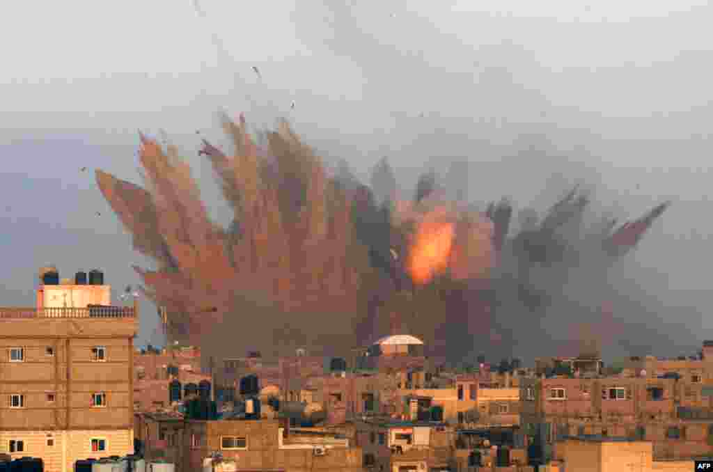 A ball of fire is seen following an Israeli air strike in Rafah, in the southern of Gaza Strip. Israeli warplanes kept up deadly raids on Gaza but failed to stop Palestinian militants firing rockets across the border, as the U.S. offered to help negotiate a truce.