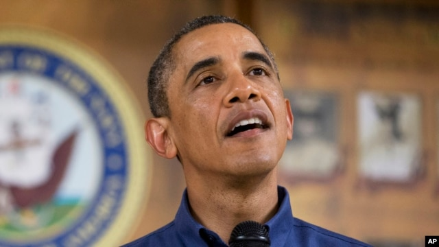 President Barack Obama speaks to members of the military and their families at a Marine Corps Base Hawaii, Dec. 25, (AP Photo/Carolyn Kaster)