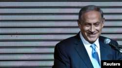 Israeli Prime Minister Benjamin Netanyahu delivers a speech to supporters at party headquarters in Tel Aviv, March 18, 2015.
