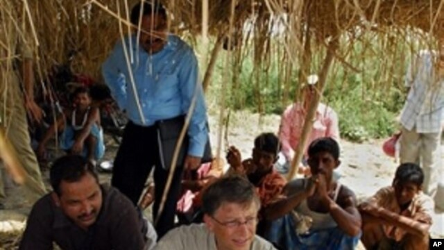 FILE photo showing Microsoft co-founder Bill Gates, center, in a remote village in eastern India to see the progress of the Indian government's campaign to eradicate polio.