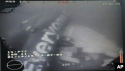 This underwater photo shows the wreckage of AirAsia Flight QZ 8501 lying on the sea floor in the Java Sea.