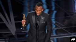 "FILE - Mahershala Ali accepts the award for best actor in a supporting role for ""Moonlight"" at the Oscars in Los Angeles, Feb. 26, 2017."