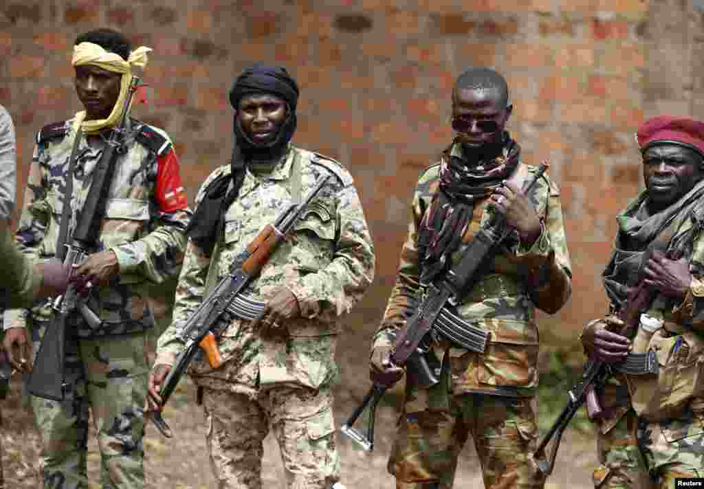 SELEKA Conservation experts report evidence that non-state militias of Seleka forces recently killed at least 26 elephants in Central African Republic's Sangha Mbaere reserve. Armed fighters face a photographer at a Seleka base in Bambari on May 31, 2014.