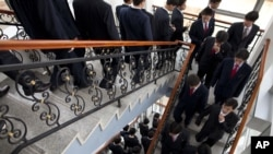 FILE - Students at the Pyongyang University of Science and Technology descend stairs after a seminar and lecture, Oct. 5, 2011.